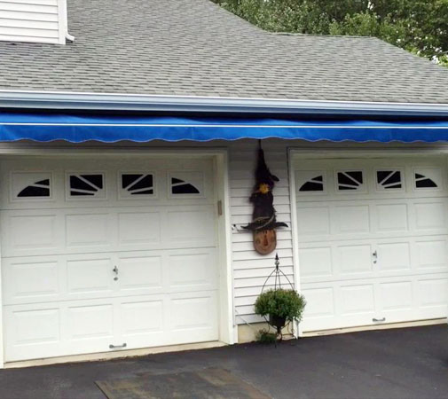 You can place retractable awnings on the side of the garage where the sun faces during the hottest part of the day