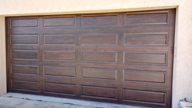 New Insulated Long Raised Panel Steel Garage Door - After