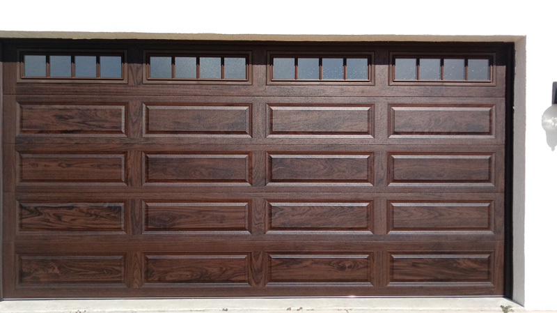 The latest Accents Finish by CHI Overhead Doors—Walnut after
