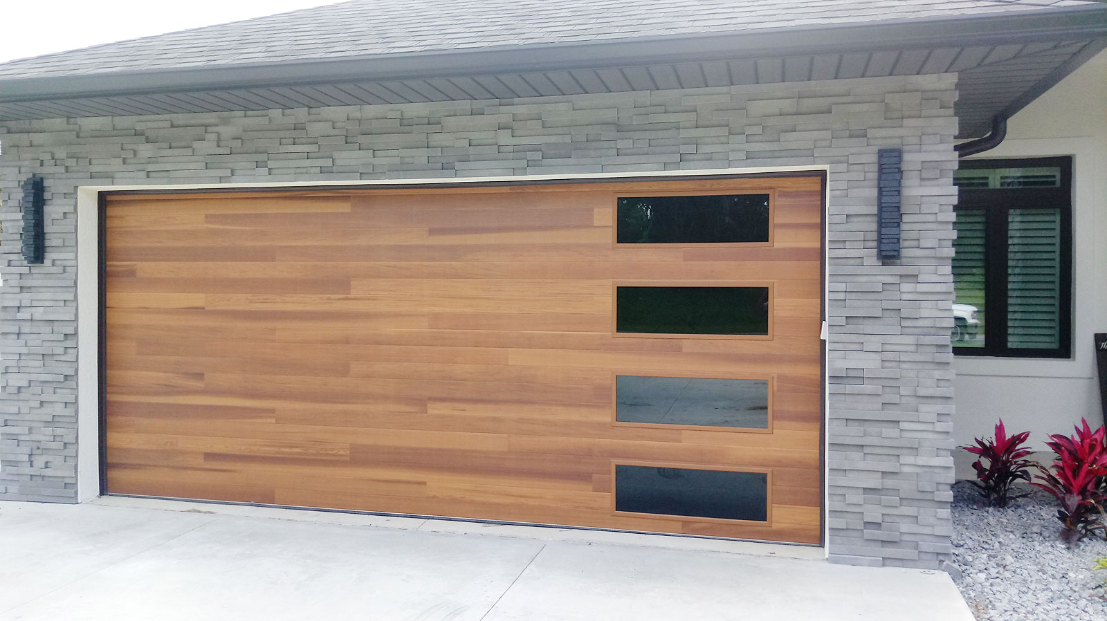 Beautiful Cedar Plank Garage Door with Tinted Glass