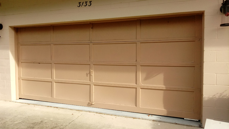 Driftwood Planks Garage Door - before - Omega Garage Doors, Florida